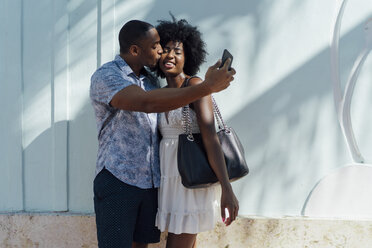 Young couple kissing and taking a selfie - BOYF00804