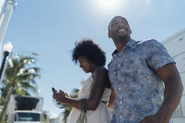 USA, Florida, Miami Beach, happy young couple on the move in the city - BOYF00837