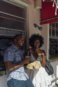 Happy young couple having a drink at a kiosk - BOYF00849