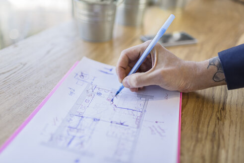 Close-up of architect working on construction plan - VGF00095