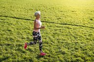 Senior woman running on rural meadow - DIGF05445