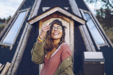 Portrait of a laughing young woman infront of a Finnish house - RSGF00103