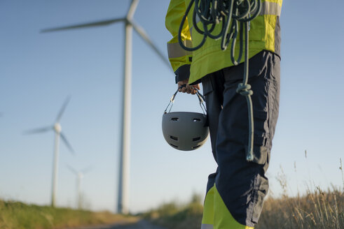 Close-up of technician at a wind farm with climbing equipment - GUSF01326