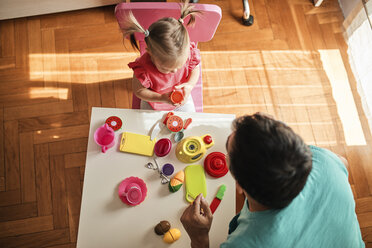 Little girl playing together with her father at home, top view - ZEDF01749