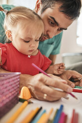 Portrait of little girl drawing together with her father - ZEDF01755