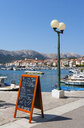Croatia, Kvarner Gulf, Baska, Sign of restaurant on promenade - WWF04425