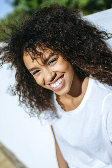 Portrait of laughing young woman with curly hair - KIJF02117