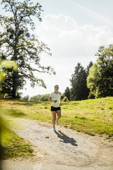 Young woman running in a park - MOEF01484