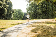 Young woman running in a park - MOEF01544