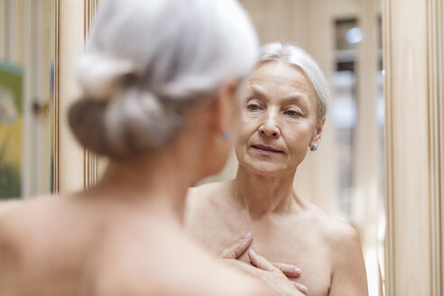 Senior woman looking at her mirror image - VGF00112