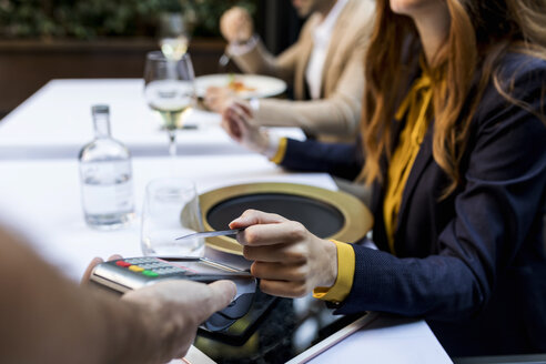 Woman paying with credit card in a restaurant - VABF01669