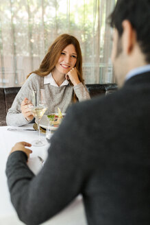Smiling woman looking at man in a restaurant - VABF01687