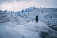 Full length of hiker standing on glacier - CAVF54164