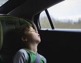 Boy sleeping while traveling in car - CAVF54212