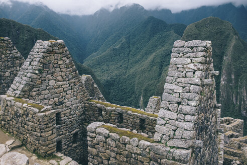 High angle view of old ruins and mountains at Machu Picchu - CAVF54230