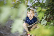 High angle portrait of girl sitting in lake - CAVF54299