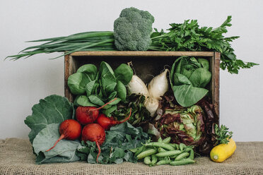 Vegetables with wooden box and burlap on table - CAVF54338