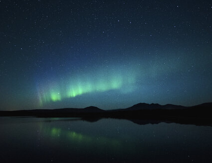 Majestic view of river against star field and aurora borealis - CAVF54524