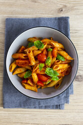 Penne with tomato and basil in bowl from above - GIOF04820