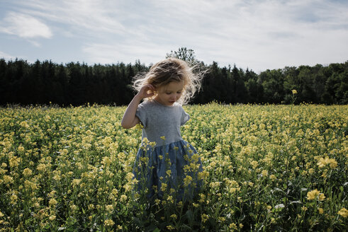 Cute girl standing amidst plants against sky - CAVF54672