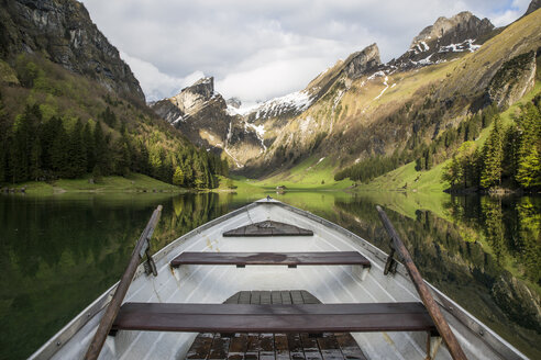 Cropped image of boat on lake by mountains - CAVF54723