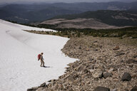 High angle view of woman on snowcapped mountain during sunny day - CAVF54867
