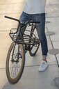 Close-up of man with commuter fixie bike on concrete slabs - VPIF01049