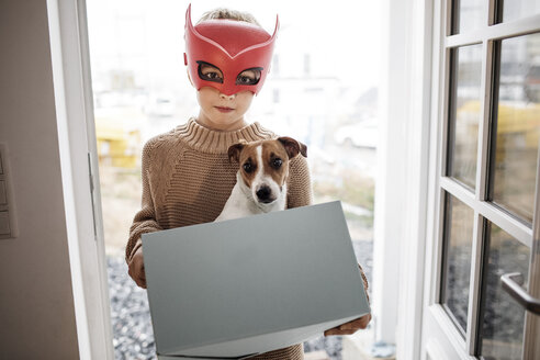 Portrait of boy wearing Superhero mask with Jack Russel Terrier in - KMKF00654