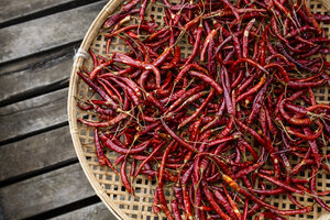 Chili Peppers in a Basket at Inle Lake, Shan State, Myanmar - AURF07724