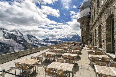Observation deck with tables and chairs in mountain, Zermatt, Valais, Switzerland - AURF07841