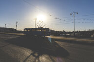 Russia, Moscow, Silhouette of a tram crossing a bridge over Moskva river - WPEF01110