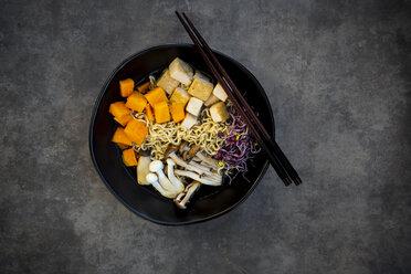 Miso Ramen soup with noodles, hokaido pumpkin, red radish sprouts, fried tofu, shimeji mushroom and king trumpet mushroom - LVF07545