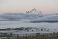 Scenic view of mountains by clouds against sky - CAVF55180
