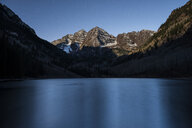 Scenic view of Maroon Lake by mountain against sky during sunset - CAVF55654