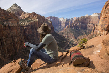 Side view of woman sitting on cliff at Bryce Canyon National Park - CAVF55825