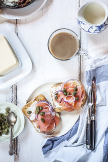 Slices of toast with smoked salmon, caperberries, onion rings, and coffee - SBDF03822