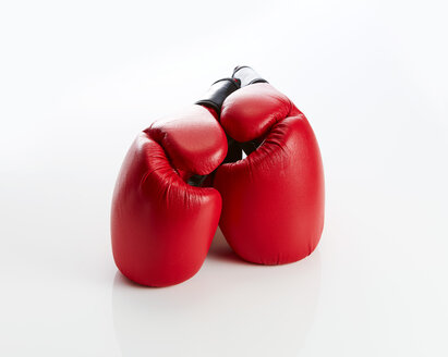 Red boxing gloves against white background - KSWF01986