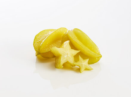 Whole and slices of star fruits on white background - KSWF01992