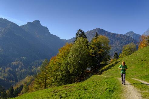 Germany, Bavaria, Upper Bavaria, Chiemgau, near Schleching, Achen Valley, hiker on hiking trail - LBF02260
