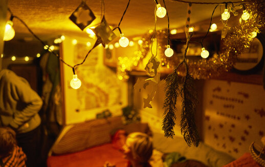 Fairy lights in camper with family in background - SSCF00045