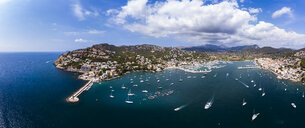 Spain, Balearic Islands, Mallorca, Andratx Region, Aerial view of Port d'Andratx, coast and natural harbour with lighthouse - AMF06240
