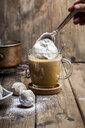 Pumpkin spice latte with a dollop of cream and some cookies - SBDF03834