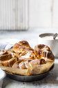 Tray of home-baked cinnamon buns with icing sugar - SBDF03846