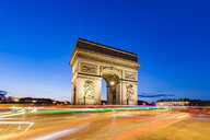 France, Paris, Place Charles-de-Gaulle, Arc de Triomphe and traffic at night with light trails - WDF04887