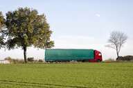 Germany, Lower Saxony, truck on country road - KLR00753