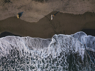 Indonesia, Bali, Aerial view of surfer at Balian beach - KNTF02350