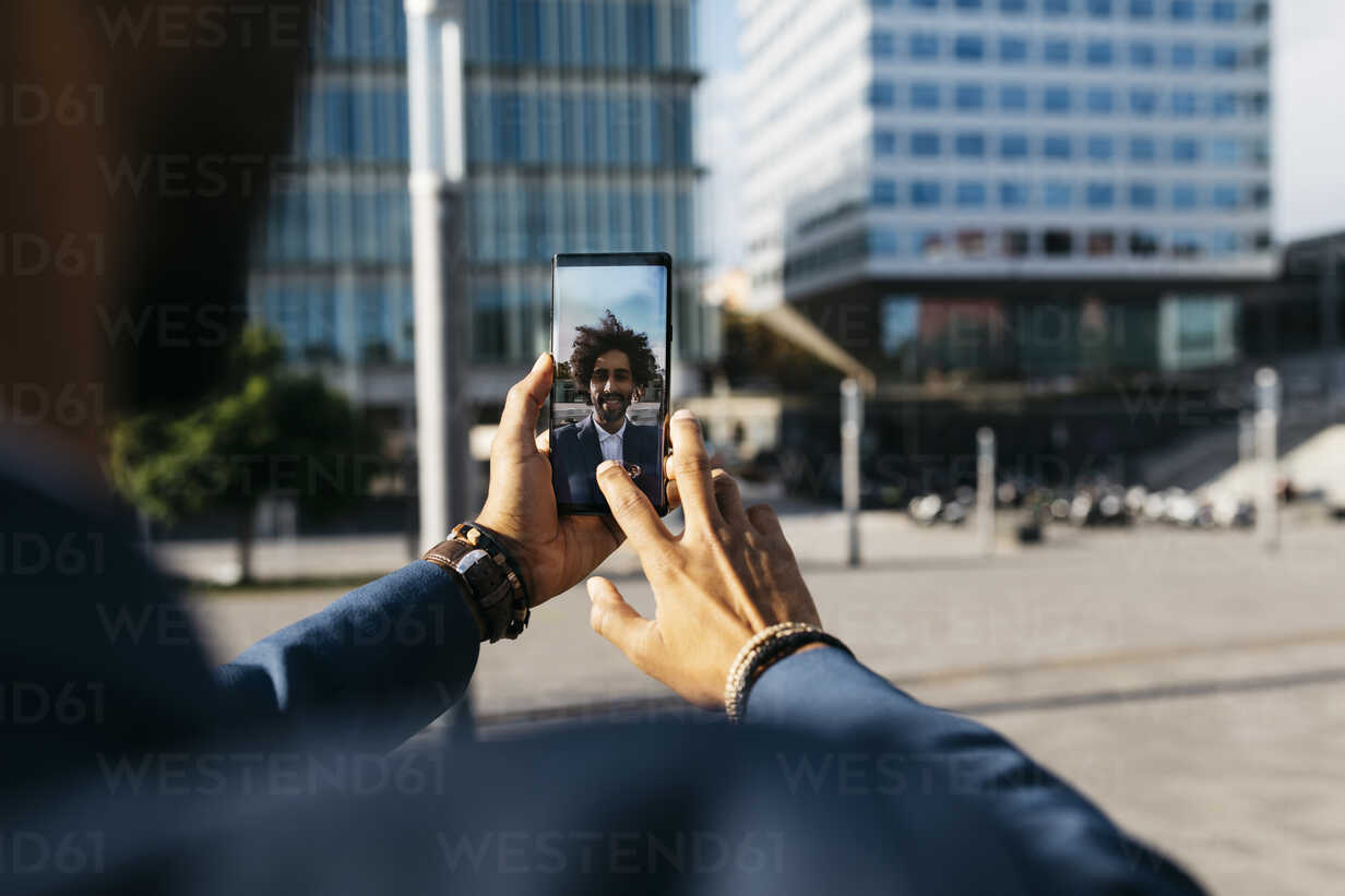 Spain, Barcelona, close-up of young businessman taking a selfie in the city - JRFF02047 - Josep Rovirosa/Westend61