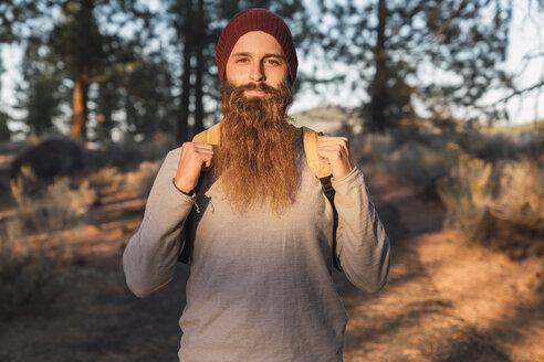USA, North California, portrait of bearded man in a forest near Lassen Volcanic National Park - KKAF02981