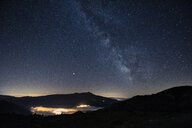 Italy, Umbria, Sibillini National Park, Milky Way over Sibillini mountains at night - LOMF00776