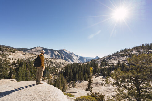 USA, California, Yosemite National Park, hiker standing on viewpoint - KKAF03016